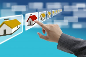 man hand Finding new property in real estate market with electro